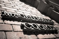 Magistrates courts building sign [1009114254]