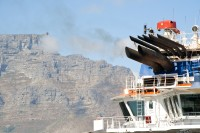Smoking tugboat and Table Mountain [1102051135]