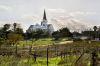 Church on a hill behind vineyards [1106176122]