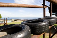 Old tyres in a play park [1107077121]