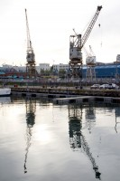 Waterfront harbour cranes reflecting [1108290261]