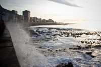 Waves crashing against Sea Point promenade [1111191651]