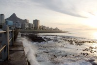 Waves crashing against Sea Point promenade [1111191655]