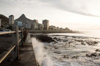 Waves crashing against Sea Point promenade [1111191661]