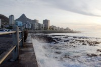 Waves crashing against Sea Point promenade [1111191662]