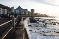 Waves crashing against Sea Point promenade [1111191684]