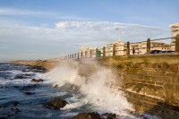 Waves crashing against Sea Point promenade [1111191705]