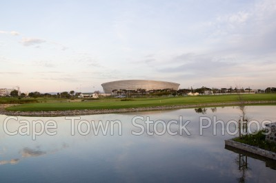 reflection,dam,cape town stadium,dusk
