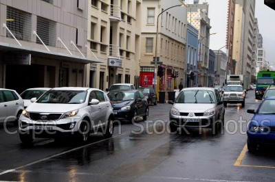 city,cars,buildings,rain,long street,roads