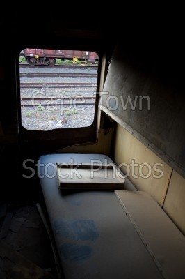 dilapidated,windows,train,bed