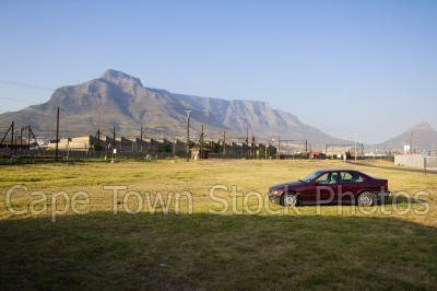 car,blue sky,table mountain,devil's peak