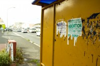 Torn abortion sign on a bus shelter [1201265367]