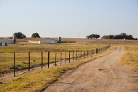 Farm's dirt road with fence [1201265452]