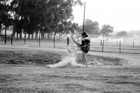 Girls kicking dust up on a dirt road [1201265472]