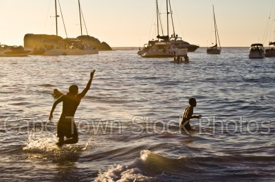boat,beach,people,clifton 4th beach,silhouette,yacht,kids,children,waves