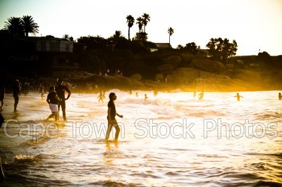 beach,people,sunset,clifton 4th beach,silhouette,kids,children,waves,girls