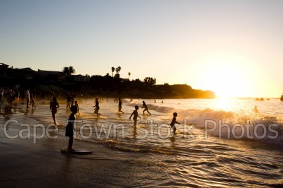 beach,people,sunset,clifton 4th beach,silhouette,kids,children,waves
