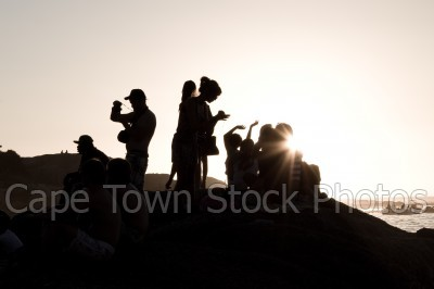 people,sunset,silhouette,rocks