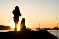 Silhouette of two girls at sunset [1202185932]