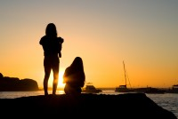 Silhouette of two girls at sunset [1202185934]