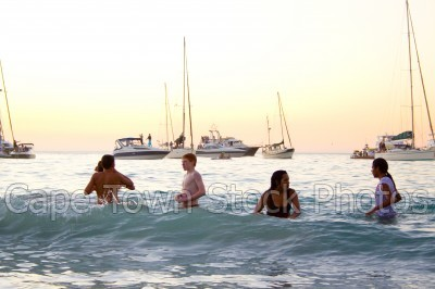 boat,beach,people,sunset,woman,clifton 4th beach,silhouette,yacht,kids,children,girls