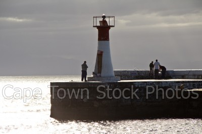harbour,cloud,kalk bay,man,sun,lighthouse,sunrise,sunset,person