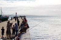 Fishing from the pier in Kalk Bay [1203046225]