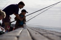 Dad helping son to fish [1203046236]