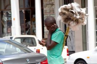 African man selling dusters [1203046457]