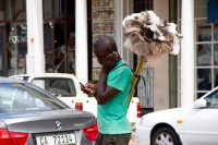African man selling dusters [1203046458]