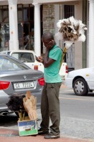 African man selling dusters [1203046459]