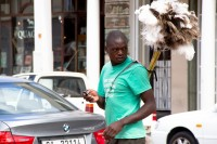 African man selling dusters [1203046460]