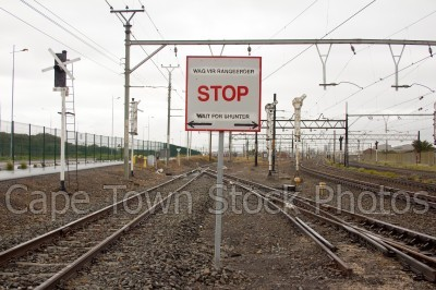 salt river,railway tracks,stop,signs