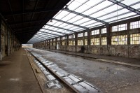 Inside a dilipidated old building with railway tracks [1204016959]