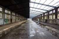Inside a dilipidated old building with railway tracks [1204016962]
