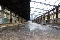 Inside a dilipidated old building with railway tracks [1204016963]