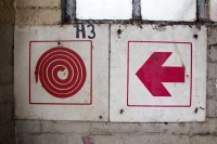 Firehose and red arrow sign [1204017035]