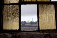 Looking out a dirty old windows [1204017048]