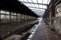 Dilapidated old building with railway lines [1204017060]