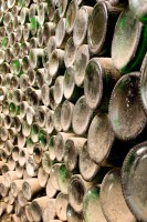 Bottoms of dusty, stacked, wine bottles [1204117374]