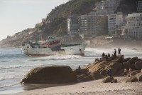 Watching stranded ship on Clifton beach [1205128229]
