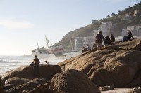 Watching stranded ship on Clifton beach [1205128238]