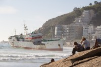 Watching stranded ship on Clifton beach [1205128242]