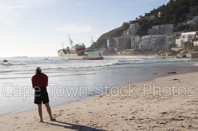 man,boat,beach,people,clifton