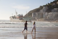 Walking past stranded ship on Clifton beach [1205128261]