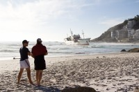 Watching stranded ship on Clifton beach [1205128287]