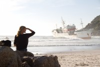 Watching stranded ship on Clifton beach [1205128321]