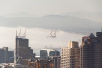 Mist rolling into Cape Town city [1206168727]
