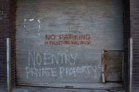 No parking sign on garage door [1208189481]