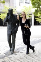 Woman with male statue [1302104372]